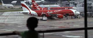 Missed emails, hepatitis keep 15 from boarding doomed AirAsia Flight QZ8501